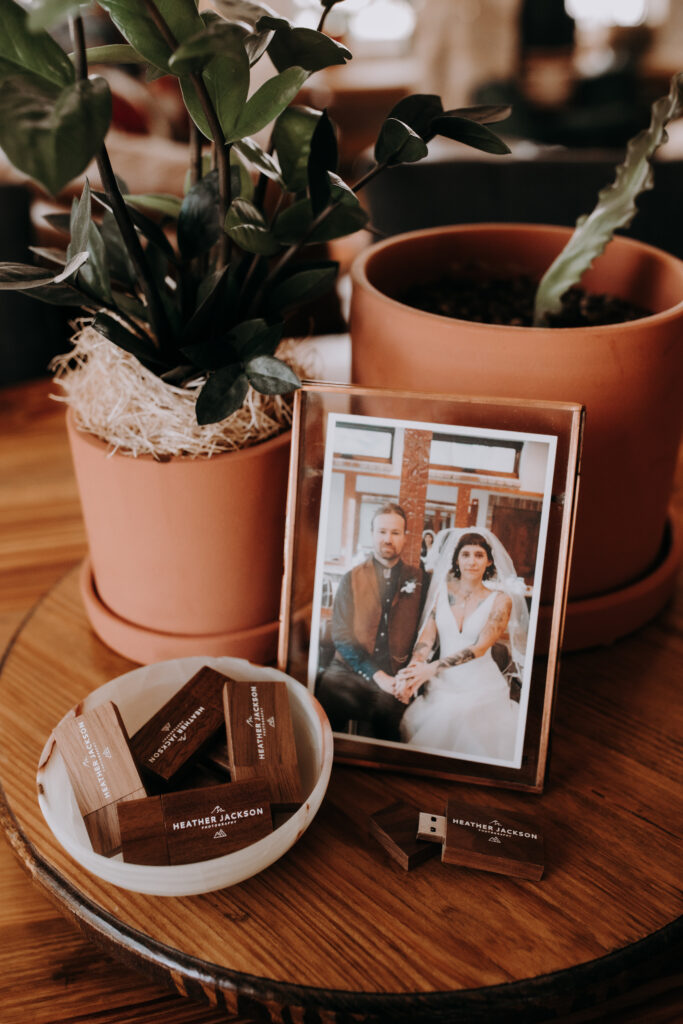 framed photo of a married couple sitting on a table